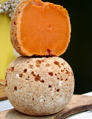 Mimolette is a hard cow' s milk cheese produced around the city of Lille. You can find it at Le Marche du Quartier.