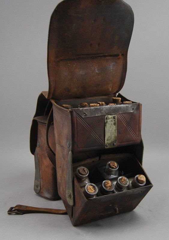 Doctor's Leather Saddlebag. The marked Elliot's Patent January 12, 1870 St. Louis, MO. doctors saddle bag has 24 glass medicine bottles.