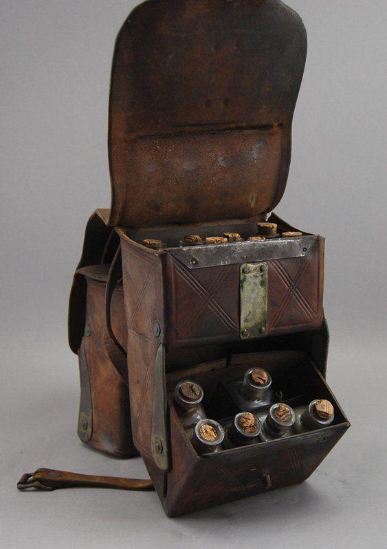 Doctor's Leather Saddlebag. The marked Elliot's Patent January 12, 1870 St. Louis, MO. doctors saddle bag has 24 glass medicine bottles.