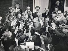 Harold Wilson surrounded by children on polling day in Huyton, 1966