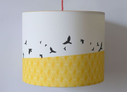 PENDANT LAMPSHADE FITTING  CHOOSE FROM THE DROP DOWN BOX FOR DIFFERENT SIZE OPTIONS  'FREE FLYING' BIRDS AGAINST A PATTERNED YELLOW BORDER.   DIGITALLY PRINTED USING PIGMENT INKS ONTO A HEAVY TEXTURED CANVAS MATERIAL.   FINISHED BY ROLLING ONTO SOLID WOODEN RINGS TO CREATE THE SIMPLE AND NATURAL LOOK OF THE LAMPSHADE.  PROTECTED WITH A MATTE VARNISH.  40WATT MAXIMUM BULB.