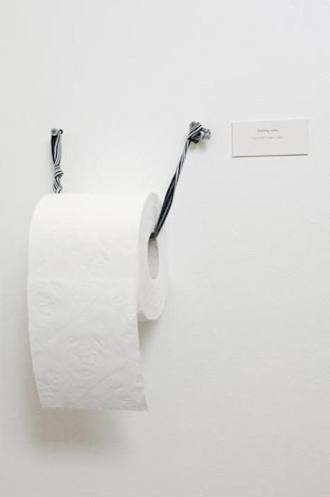 Two nails with a twisted length of cotton yarn comprise this toilet roll holder in a Copenhagen bath; via OWI.