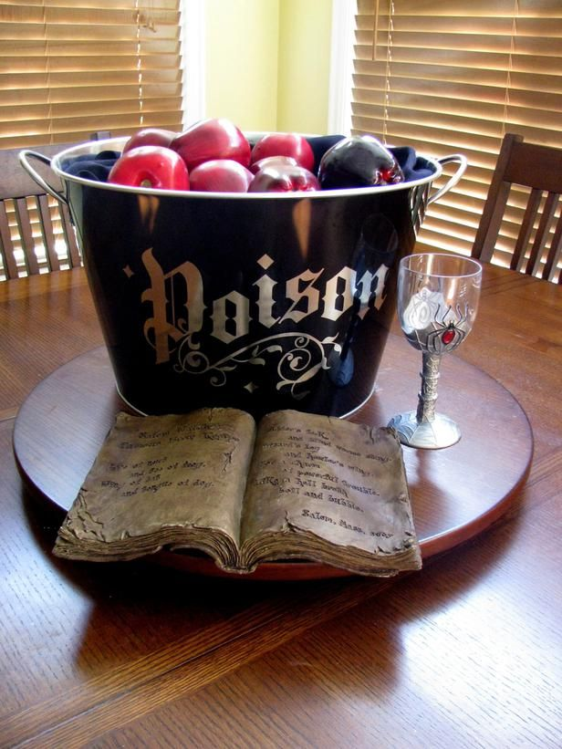 Clever idea: Placing fake red apples in a black 'Poison' pot and painting one apple black to symbolize a poisonous one.