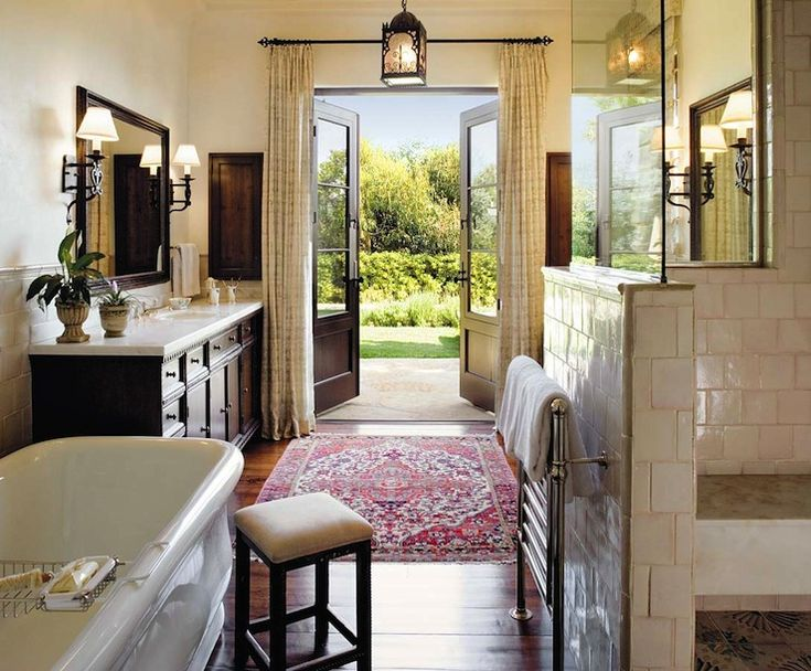 This looks like a bathroom in an Italian villa...who could resist those French doors in a bathroom?