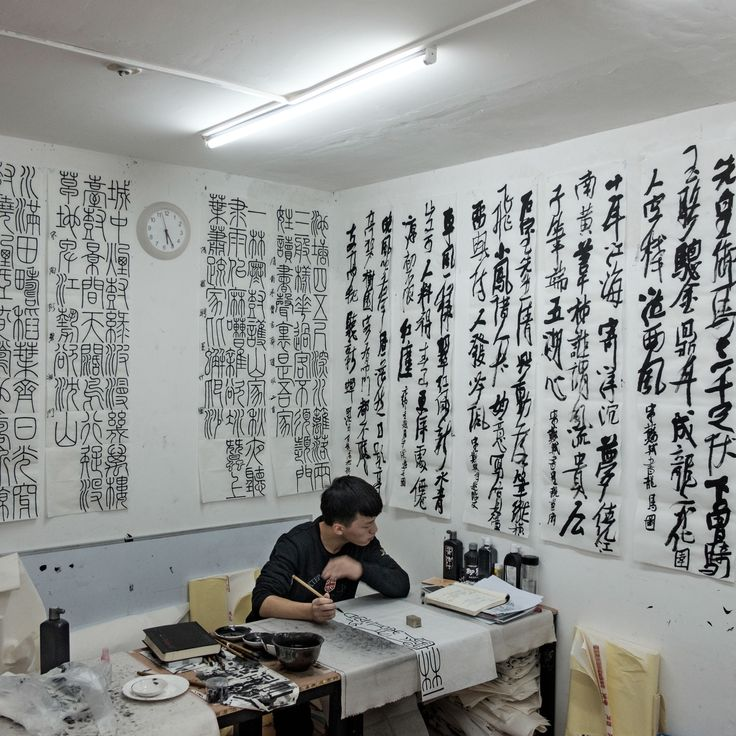 Picture of a person practicing calligraphy