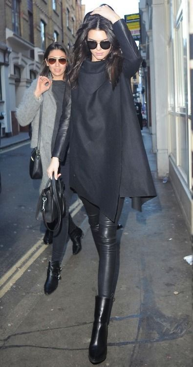 Kendall Jenner - Edgy model look | Black wrap coat with leather pants and booties #shopdailychic