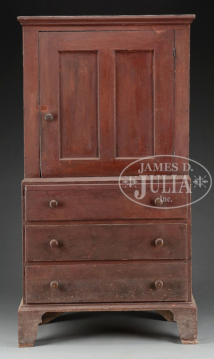 """Last quarter 18th-Century, New England. The one-piece cupboard with cove molded cornice above a raised panel cupboard door opening to an interior of three fixed shelves stepback over three long drawers with turned wood knobs on a molded base raised on large shaped bracket feet. SIZE: 70-1/2"""" h x 38-1/2"""" w x 19"""" d."""