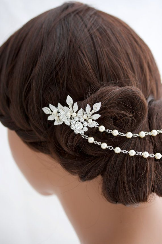 A Unique and eye catching Silver Rhodium Wedding Headpiece! Handmade featuring lovely vintage leaves and settings accented with Swarovski crystal