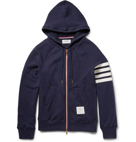 Thom Browne Loopback Cotton-Jersey Hoodie   MR PORTER   New York designer Mr Thom Browne has redefined American tailoring and his collections often have an athletic bent. This navy hoodie has been made in Japan using a soft, lightweight loopback cotton-jersey with smart detailing, such as the striped print at the sleeves and multi-coloured zip placket.