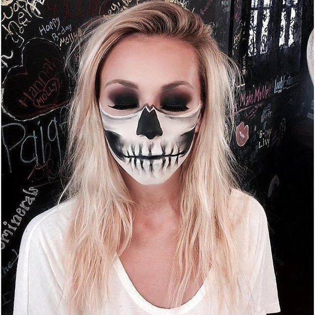 Half Skull Halloween Makeup: Please read my Buzzfeed article on many more looks! http://www.buzzfeed.com/jenniferclerici/10-skeleton-costumes-where-it-is-all-about-the-mak-1tps1