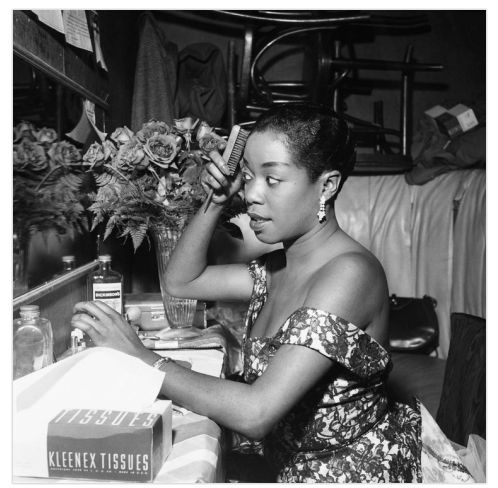 Sarah Vaughan in her dressing room,(1954).   Photo by  Bertrand Miles
