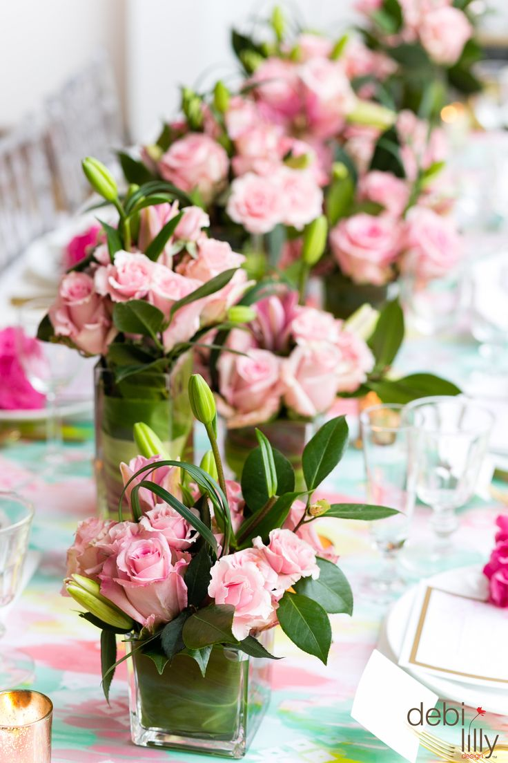 Splashes of pink across the table will