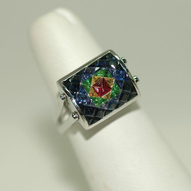 A Yin Yang ring set with 3.89 ct combination of ruby, yellow sapphire, tsavorite, blue sapphire, and 2.2 ct diamonds in 18k white gold.    Designed by Tsajon, one face of this ring is centered by a beautiful ruby from Madagascar. Moving in color tones from red to yellow, then from green to blue, this designer adornment is symbolic of the solar energy of all creation, and is one of the newest additions to our Yin Yang ring collection.Beautiful Ruby, Ct Diamonds, Blue Sapphire, Yellow Sapphire, Green Energy, 18K White, Jewelry Boxes, Yin Yang, Yang Rings