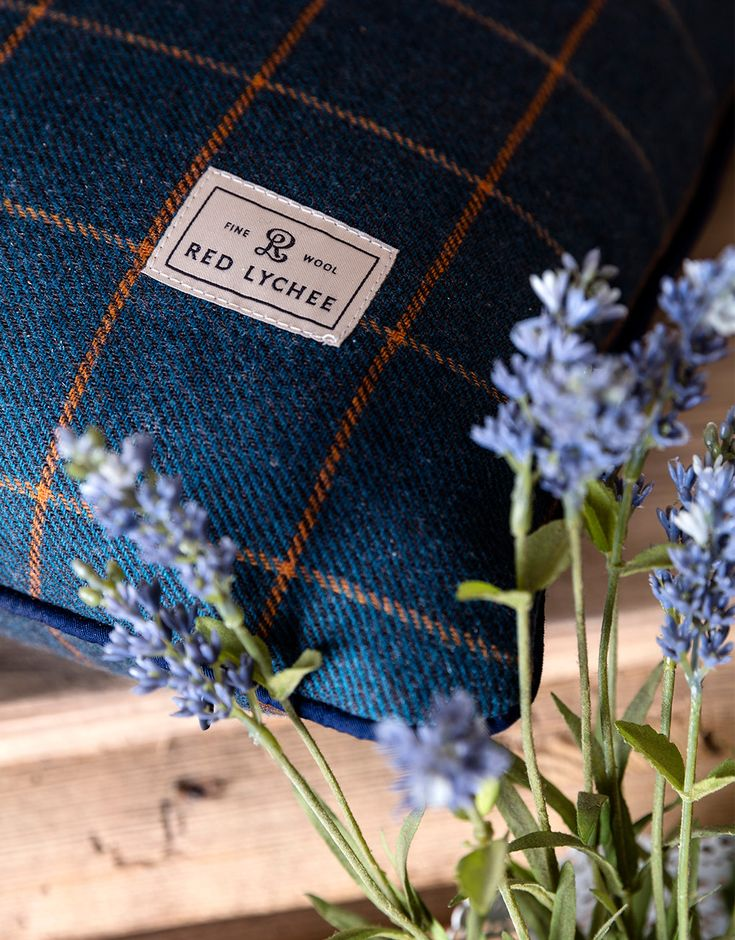 Vineyard Wool Pillows. Tartan plaid pillow is crafted from the finest wool and finished with contrasting navy blue trim.