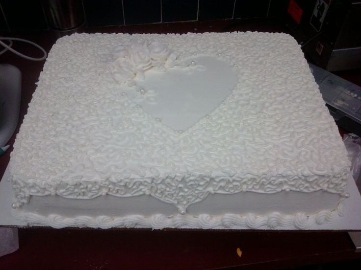 wedding sheet cake - I only had 3 hours to complet this cake.  It was very rushed. With it being ice cream you can only work on it in about 10 min increments max.  I had the order come in from our corporate office, (so we couldn't turn it down)  fed about 80 people.  This is an ice cream cake (multiple flavors and cake flavors) iced in pastry pride.  did cornelli lace and roses in bc.  I had made pearls from fondant and added luster dust for the sparkle.