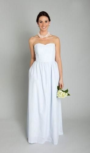 A staple for preppy brides, seersucker in muted colors is a great option for bridesmaids. This long blue seersucker gown breathes really well on a hot summer day and is the epitome of effortless refinement.