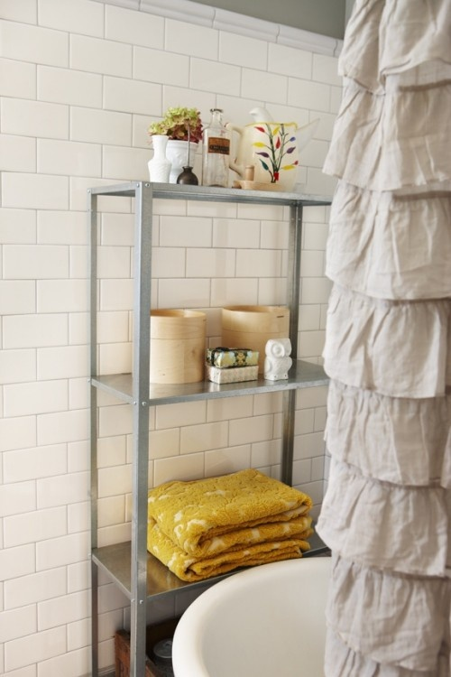 great place to tuck in extra storage...just make sure the curtain blocks the area when the shower is on...