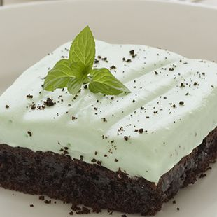 Grasshopper Dessert: Make an elegant dessert with Duncan Hines Chocolate Fudge Cake and a delightful topping flavored with green crème de menthe and white crème de cacao. They're bound to impress.