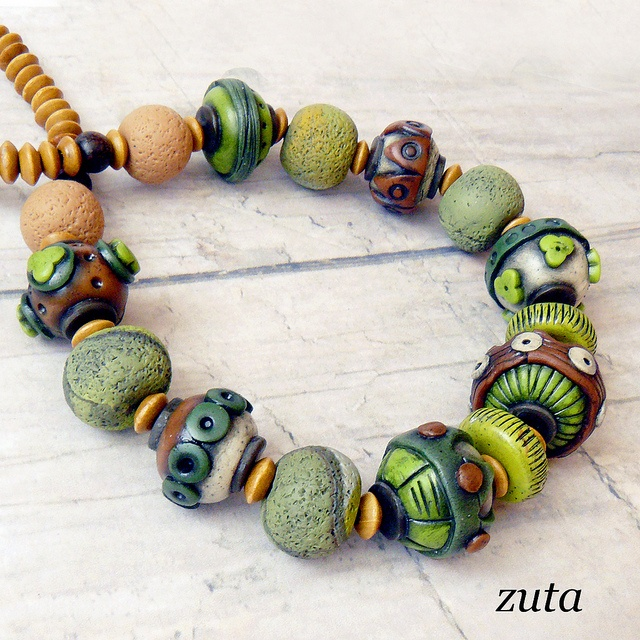 Beads by Verundela, via Flickr.  I like the neutrals with that rough texture.