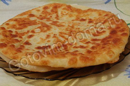 Хачапури - khachapuri  Cheese Bread, but that is an understatement, it is so much more.