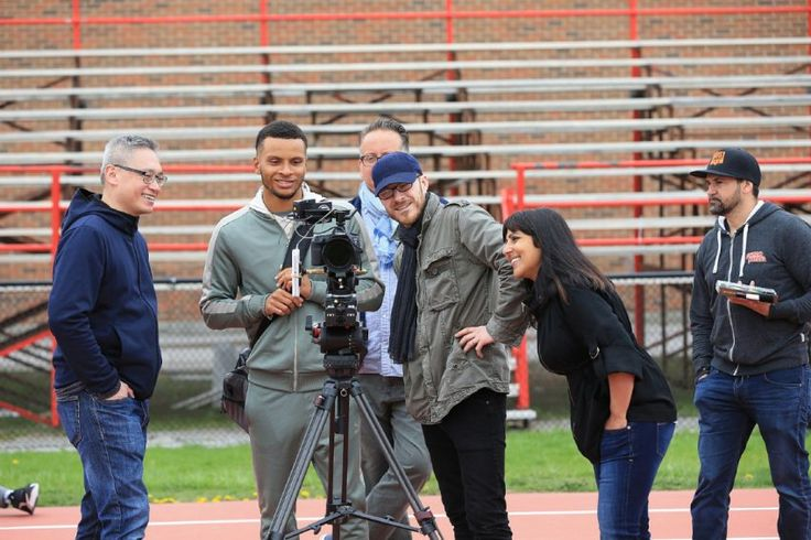 De Grasse checks out takes with the film crew for a shoot for a Pizza Pizza commercial at York University — the track where his improbable rise began. 2017
