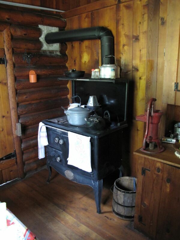 Home Interiors 1800s  I like the rustic cabin style. We have that cast iron pump, only ours is blue, not red.