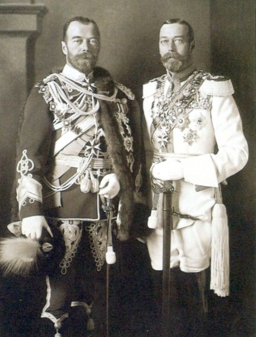 Czar Nicholas II of Russia and King George V of England. Their portraits appear on many postage stamps and it is difficult to distinguish between the two men. Can you pick who's who from this photo? The man on the left is the Czar: the uniforms may have fooled you but the royal cousins swapped them for the occasion!
