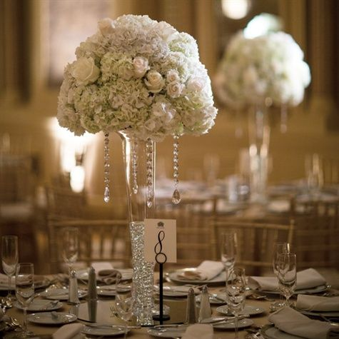 Tall Glass Vases Held Lush Arrangements Of White Roses And Hydrangeas Bouq