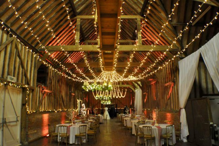 Lillibrooke Manor with a gathered fairy light canopy and gold uplighting