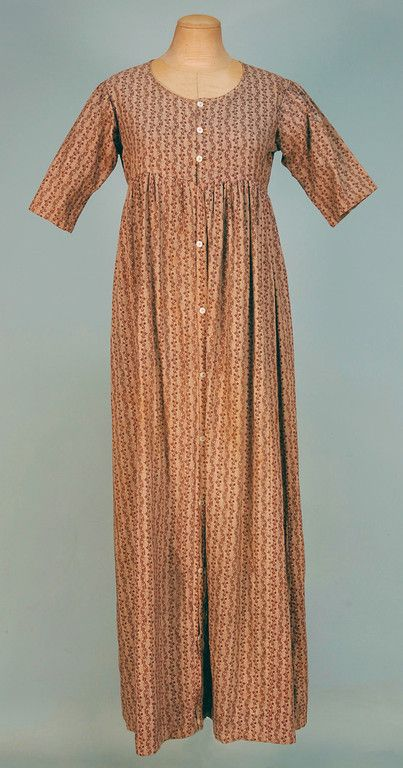 PRINTED COTTON WORK DRESS, c. 1820. 1-piece roller printed in brown and cream serpentine floral stripe having short sleeve, rounded neck and...