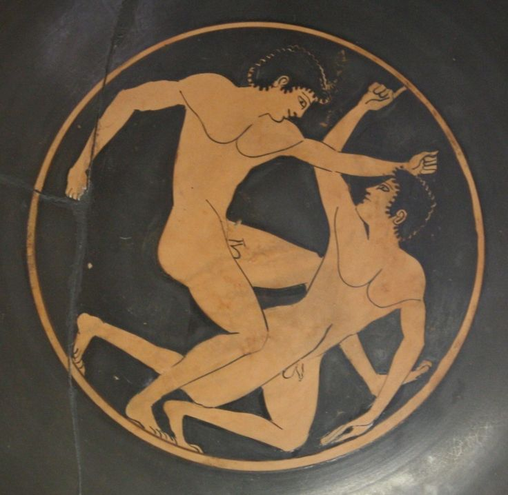 A boxing scene from an attic red-figure kylix (c. 500 BCE). Olympia Archaeological Museum.