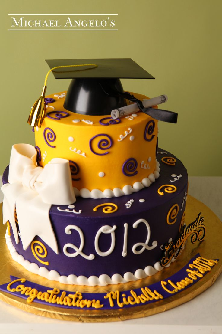 Bow & Swirls #21Graduation This cake is a two-tier round design iced in colored buttercream. The colors of this cake match the school. The fondant bow makes a great addition and sits nicely on the bottom layer. The grad cap and diploma make a great topper to any graduation cake.
