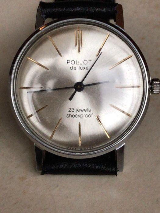 """Poljot de Luxe ultra-slim Export serie beperkte oplage - polshorloge - Sovjet-Unie 1965-jaren '70  Je biedt op een zeldzame Russische mannen mechanisch uurwerk horloge merk """"POLJOT""""-Poljot Deluxe 23 juwelen model """"ultra-slanke"""". Export series limited editie. 1965-70sElke 100% authentiek. Niet gerenoveerde horloge allemaal origineel! Het horloge met een eigen geschiedenis! Goede conditie wat betreft deze leeftijd!Horloge met nieuwe riem. Beweging is een volledig werkende staat. Houdt goede…"""