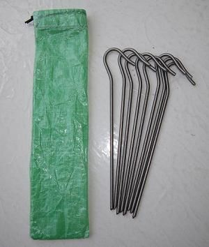 """Cuben Fiber Stake Sack:  Description: This tent stake sack is made from strong 1.43 oz/sqyd Cuben Fiber to prevent punctures. Fold the top down over your stakes and use the shock cord draw string to keep them snug like a rubber band.  It will fit at least 14 of any of our stake sizes.  Dimensions: 2.75"""" wide x 9"""" tall (7 cm x 23 cm)  Stake Sack weight: .09 oz. / 2.5 grams price: $5.45"""