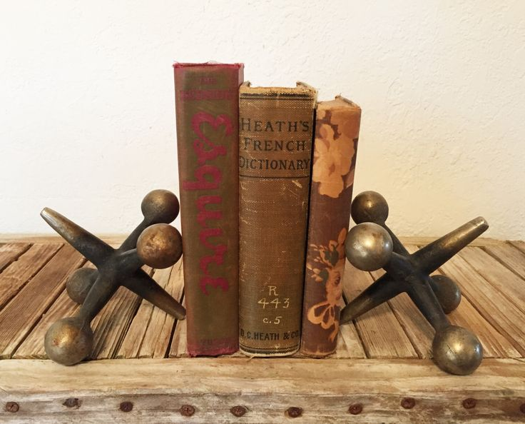 Mid Century Jacks Iron Bookends by NostalgicNuance on Etsy https://www.etsy.com/listing/243742726/mid-century-jacks-iron-bookends