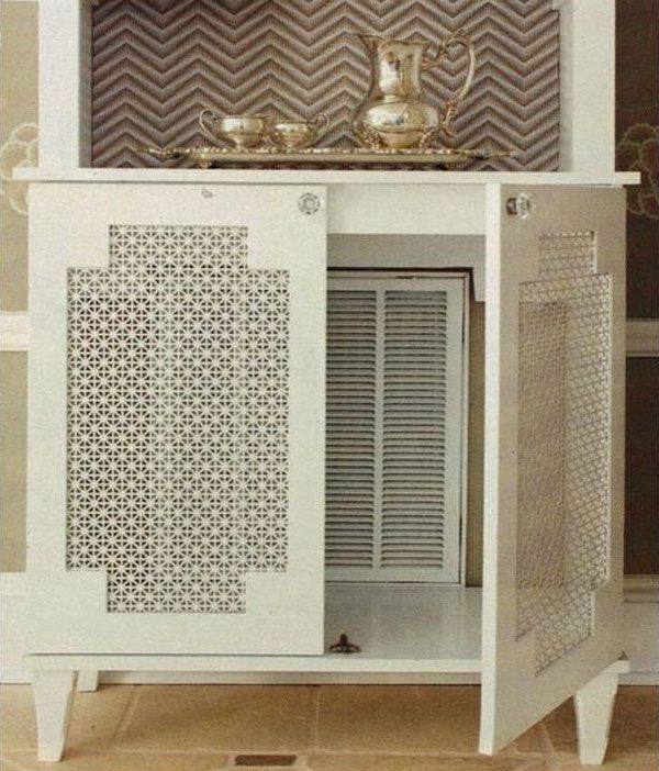 . . . isn't this the most clever idea? a beautiful shelving unit for storage and display, that also happens to disguise an unsightly vent beneath . . . [from BHG Renovation Style Magazine via the sister sophisticate]