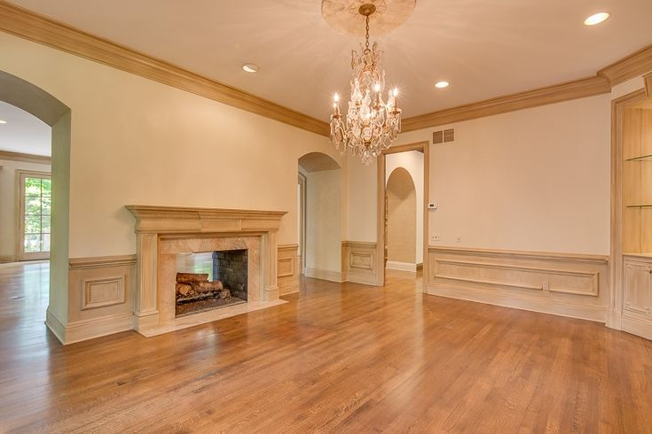 Shared fireplace joining the living room and dining room at 165 Waring Rd. Memphis, TN 38117.