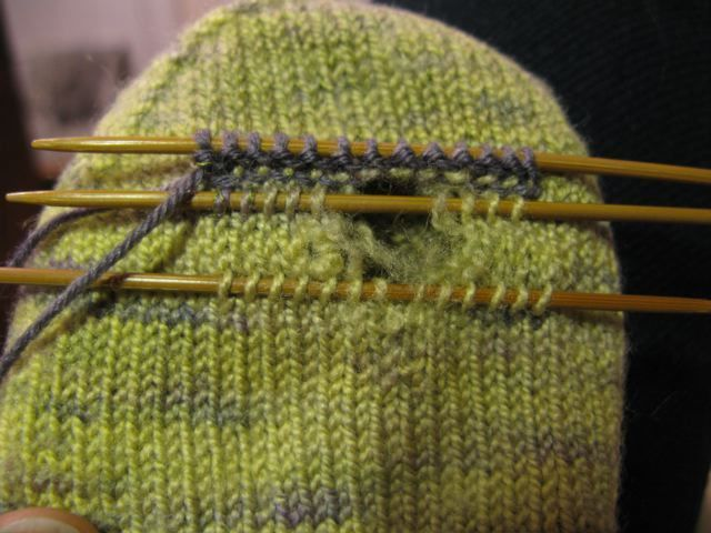Repairing a hole in knitting.