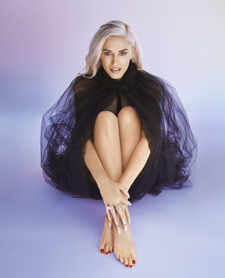 Gwen Stefani wearing a Giorgio Armani cape and a Cartier bracelet. Photographed by: Alexi Lubomirski