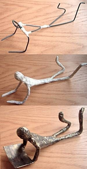 figures made from wire, masking tape and paint