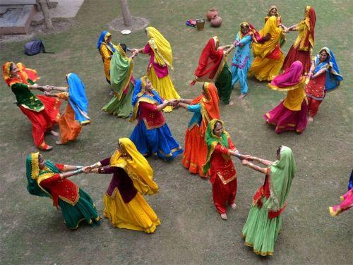 Girls, wearing traditional Punjabi dresses, celebrating 'Teej' festival in Amritsar, Deccan Herald: Photo Gallery