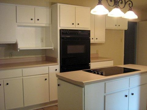 This person took old 80's kitchen cabinets and painted them white ...
