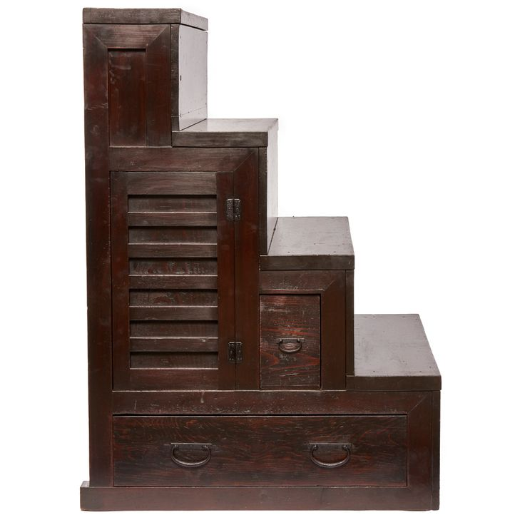 Four step staircase chest (kaidandansu) with three compartments of different size. The chest is high to the left and low at the right. Late Edo - Meiji Period. Size; W. :112,5 cm, H. : 73,5 cm, D. : 81 cm Shipping and handling not included.