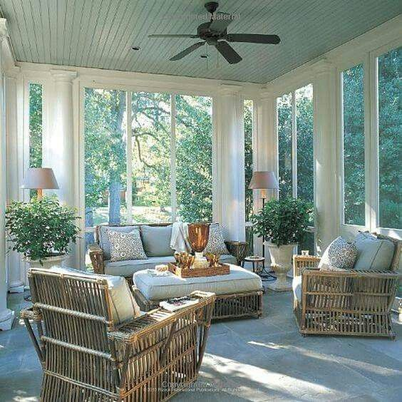 Soft sky blue ceiling and floor to ceilings windows makes it feel so cozy while nature whispers and the sun shines. I so want to curl up here now!