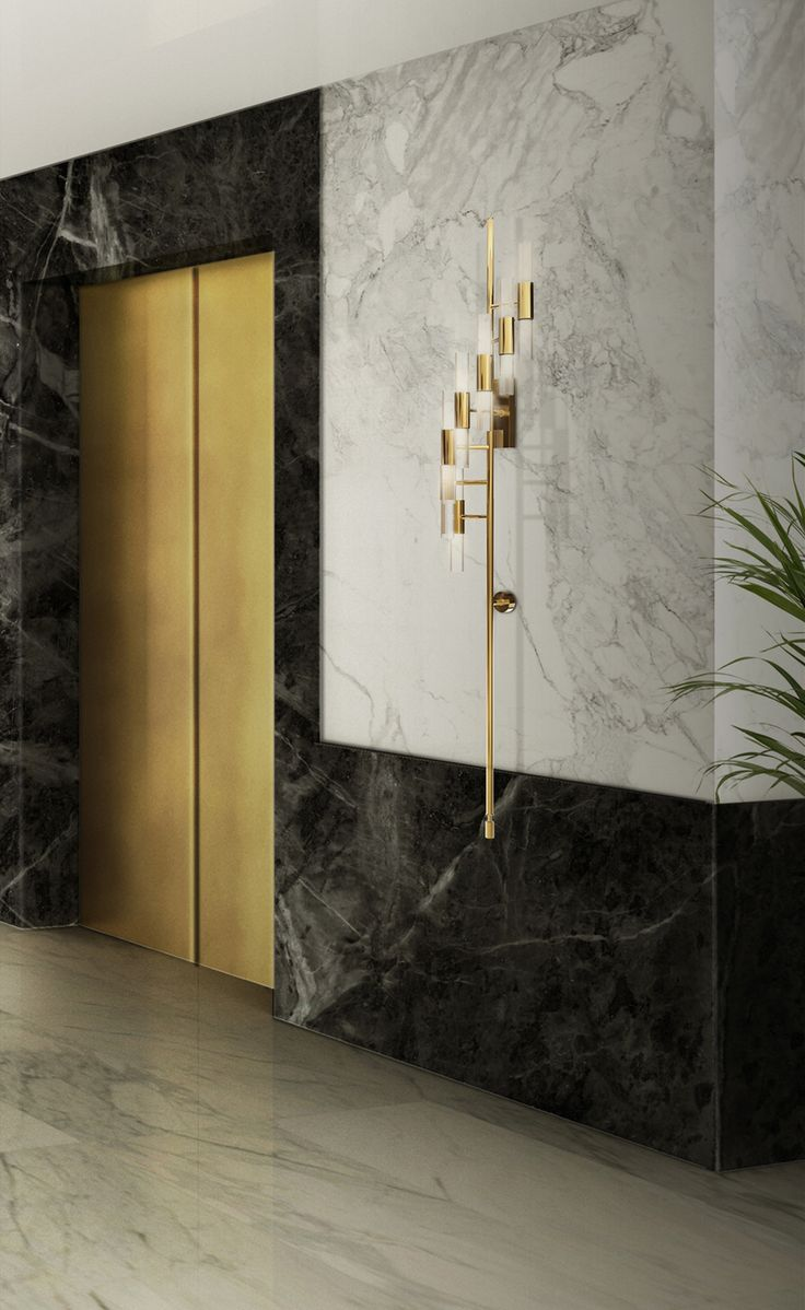 This Luxxu´s Waterfall Torch wall lighting is all about creating a classic style mood to the room.Combined with the best of contemporary and modern Curated design, made with the best brass, crystal glass and the ability of the craftsman, it's perfectly fitting on your hospitality project.