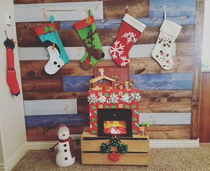 Little temporary fire place super easy and cheap. Electric fire place and mantle made from a box wrapped.  Cute idea for Christmas decorations