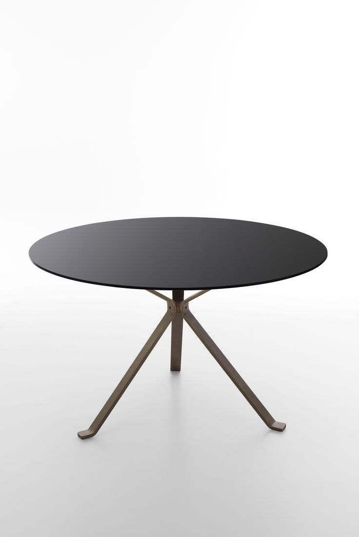 Revo table coll. Reflection  with black round glass top and vintage bronze metal legs. Product design by CMR.Color design and finishes by Raffaella Mangiarotti #focusoncolor #living #shining