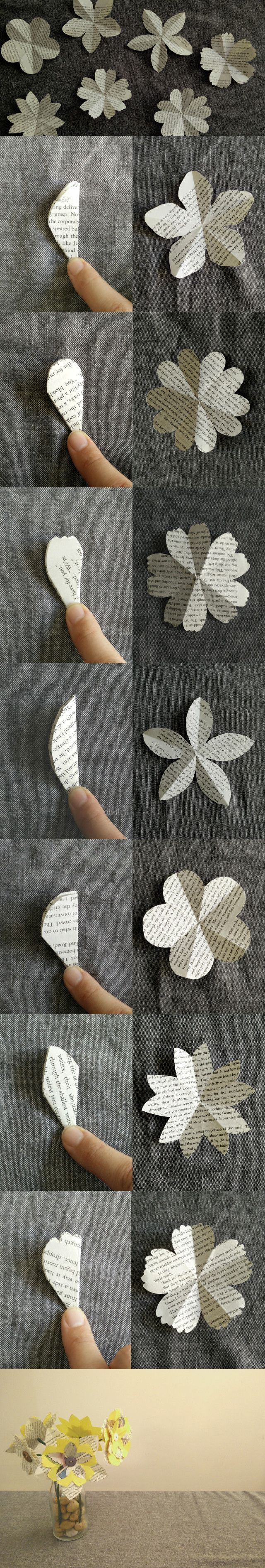 Making paper flowers out of recycled books, buttons and string
