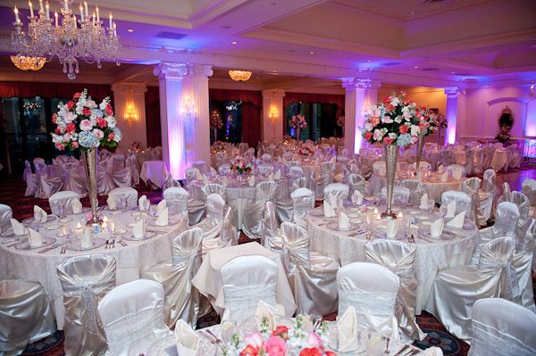 White Chairs At A Wedding Indoor Stock Photo: Beautiful Indoor Reception Seating Area