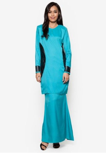 Baju Kurung Modern from Gene Martino in Blue Meant for the ladies who want to keep it modern yet traditional, this kurung from Gene Martino is definitely for you. Its simple feminine design is decorated with perforated detailing on the sides giving it a sweet modern look that is ethereal.To... #bajukurung #bajukurungmoden
